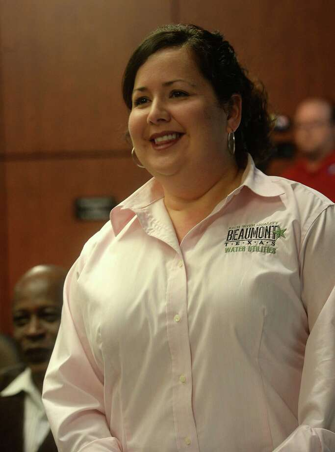 Amalia Villareal stands as she is acknowledged at Tuesday's city council meeting after being named Beaumont's new interim water utilities director. Photo taken Tuesday, April 7, 2015 Kim Brent/The Enterprise Photo: Kim Brent / Beaumont Enterprise