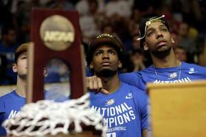 Duke freshmen Justise Winslow (center) and Jahlil Okafor are expected to leap to the NBA.