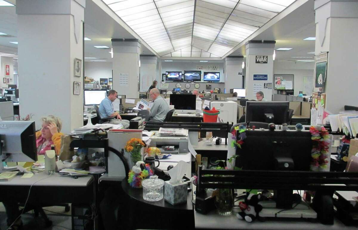 The evening crew in the San Antonio Express-News newsroom works on getting stories and photos ready for the Wednesday print edition and MySA.com and EN.com websites.