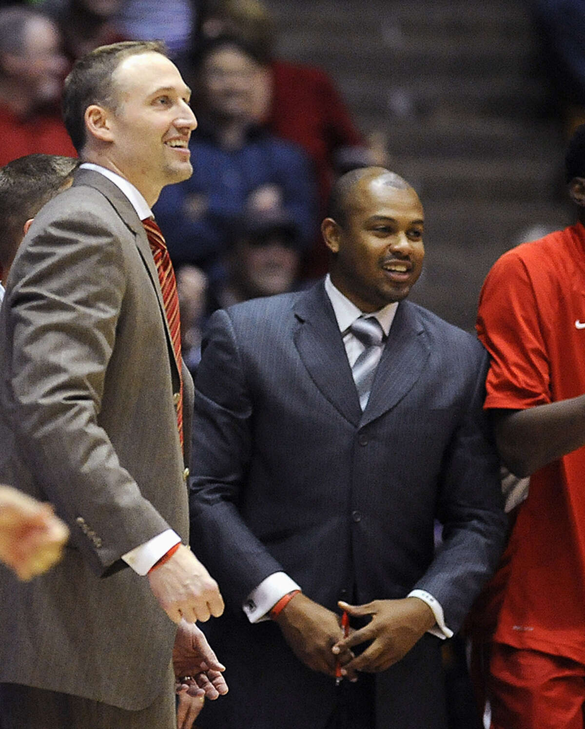 FILE - In this Nov. 17, 2013 file photo, Illinois State associate head basketball coach Torrey Ward, right, and head coach Dan Muller smile after an NCAA college basketball game against Northwestern in Evanston, Ill. Illinois State University President Larry Dietz confirmed in an email to students, faculty and staff Tuesday, April 7, 2015, that Ward was one of seven people killed when the small plane crash they were in crashed in a central Illinois field near Bloomington early Tuesday, April 7, 2015. The Cessna 414 twin-engine aircraft took off from Indianapolis and crashed just short of the Central Illinois Regional Airport in Bloomington after midnight, the Federal Aviation Administration said. The plane was returning from the NCAA Final Four tournament. (AP Photo/Matt Marton, File)