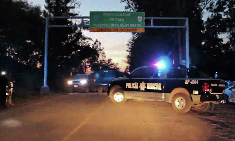 This scene is from a  video showing investigative efforts by police on a Jalisco state road where at least 15 police officers were killed in an ambush allegedly carried out by a gang called Jalisco New Generation. Photo: IVAN ISRAEL OROZCO GARCIA, Stringer / AFP