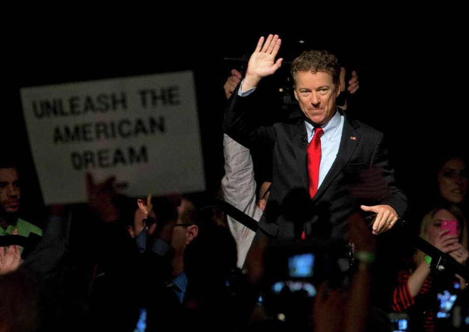 "Sen. Rand Paul, R-Ky.,  launched  his presidential campaign Tuesday with a combative message against both Washington and his fellow Republicans:    ""We have come to take our country back."" Photo: Carolyn Kaster, STF / AP"
