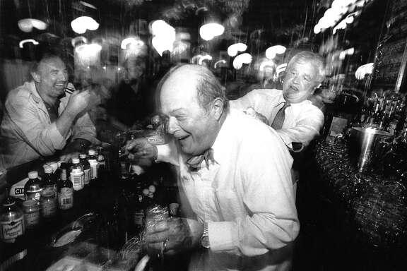 Veteran Perry's bartender Michael McCourt, right, jokes around with Scott Beach at the San Francisco establishment in 1989.