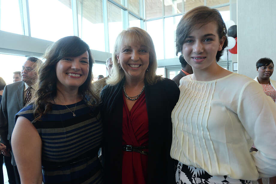 """From left, Lisa Kincaid, Jay Sheppard, and Maddie Sheppard, 14, attended the Better Business Bureau's """"Laws of Life"""" student essay contest reception at the Event Centre Tuesday. Photo taken Tuesday, April 7, 2015 Kim Brent/The Enterprise Photo: Kim Brent / Beaumont Enterprise"""