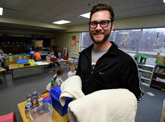 Zac Halloran holds blankets that he sells to raise money for the Leukemia & Lumphoma Society Friday, April 3, 2015 at the TSL Adventures day care in Rensselaer, N.Y. (Skip Dickstein/Times Union) Photo: SKIP DICKSTEIN / 00031306A