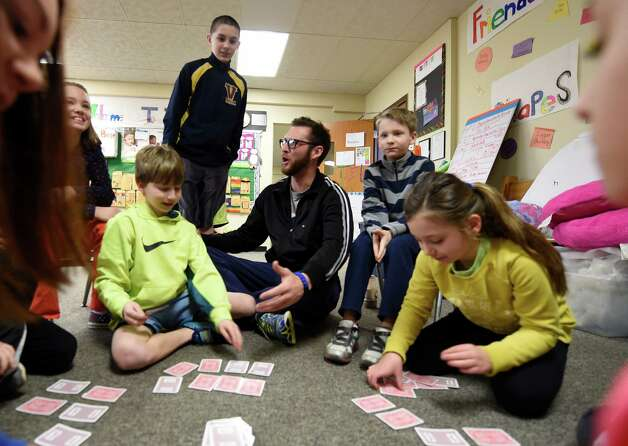 Zac Halloran, center, interacts with students Friday, April 3, 2015 at the TSL Adventures day care in Rensselaer, N.Y. (Skip Dickstein/Times Union) Photo: SKIP DICKSTEIN / 00031306A
