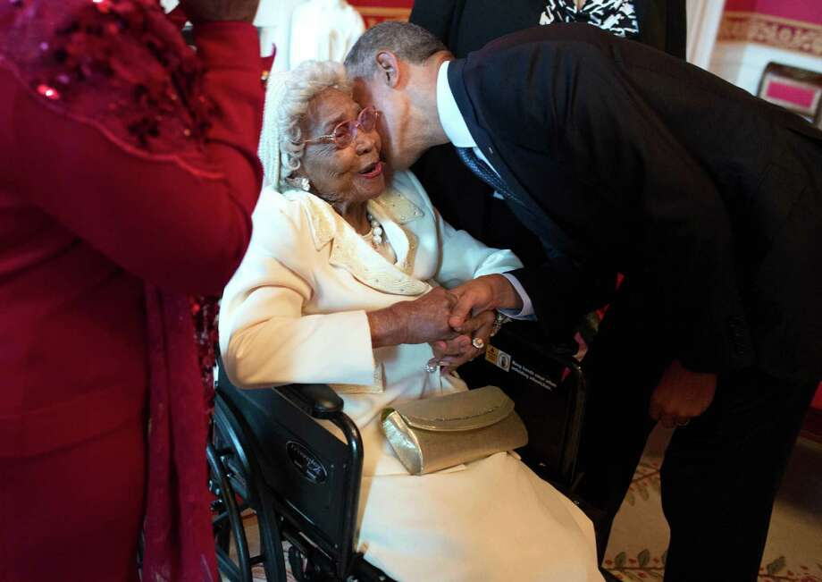 "President Barack Obama greets Houston's Emma Primas, 109, before an Easter prayer breakfast in the Tuesday in East Room of the White House. ""I didn't think I'd ever see what I'm looking at now,"" she said. Photo: Pete Souza, Official Photographer / This official White House photograph is being made available only for publication by news organizations and/or for personal use"