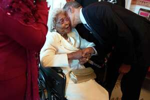 "President Barack Obama greets Houston's Emma Primas, 109, before an Easter prayer breakfast in the Tuesday in East Room of the White House. ""I didn't think I'd ever see what I'm looking at now,"" she said."