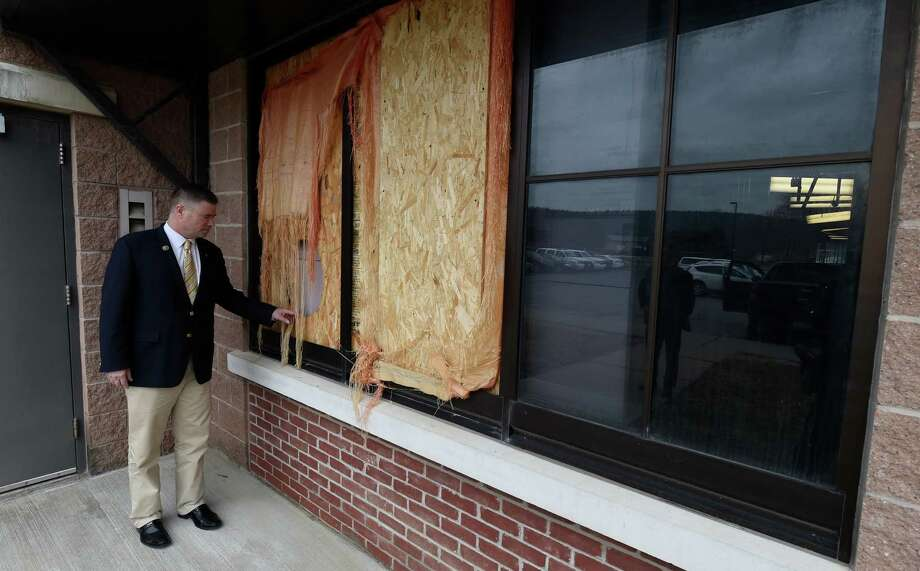 Congressman Chris Gibson inspects the exterior of the Harvey E. Stoddard Public Safety Facility which is still in disrepair Tuesday April 7, 2015 three years after Hurricane Irene in Schoharie, N.Y.  Congressman Gibson and other local elected officials met with the media at the facility to talk about FEMA's response to the needs of the Schoharie County Sheriff's Department.  (Skip Dickstein/Times Union) Photo: SKIP DICKSTEIN / 00031330A