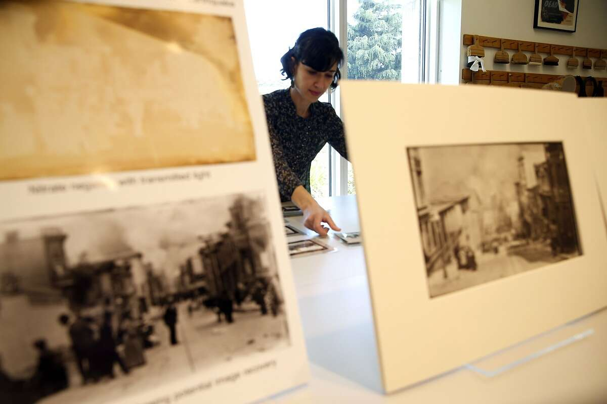Victoria Binder, Associate Conservator, looks through 1906 earthquake photos taken by Arnold Genthe at Palace of the Legion of Honor in San Francisco Calif., on Tuesday, April 7, 2015.