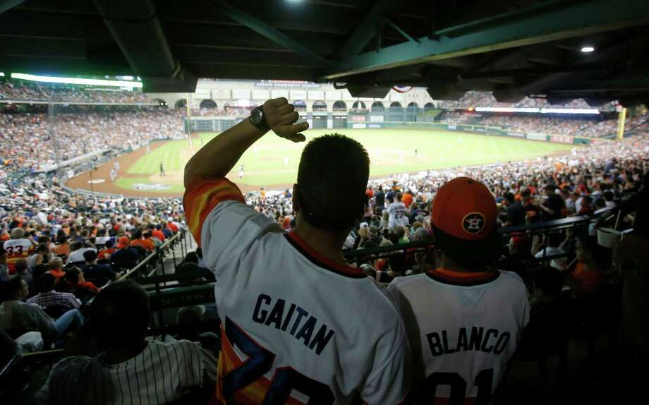 Anthony Gaitan and Kristian Blanco were part of an overflow crowed of 43,753 on hand at Minute Maid Park on Monday night, and the opening game was a big draw on television as well, at least compared to last season's anemic broadcast audiences. Photo: Jon Shapley, Staff / © 2015 Houston Chronicle