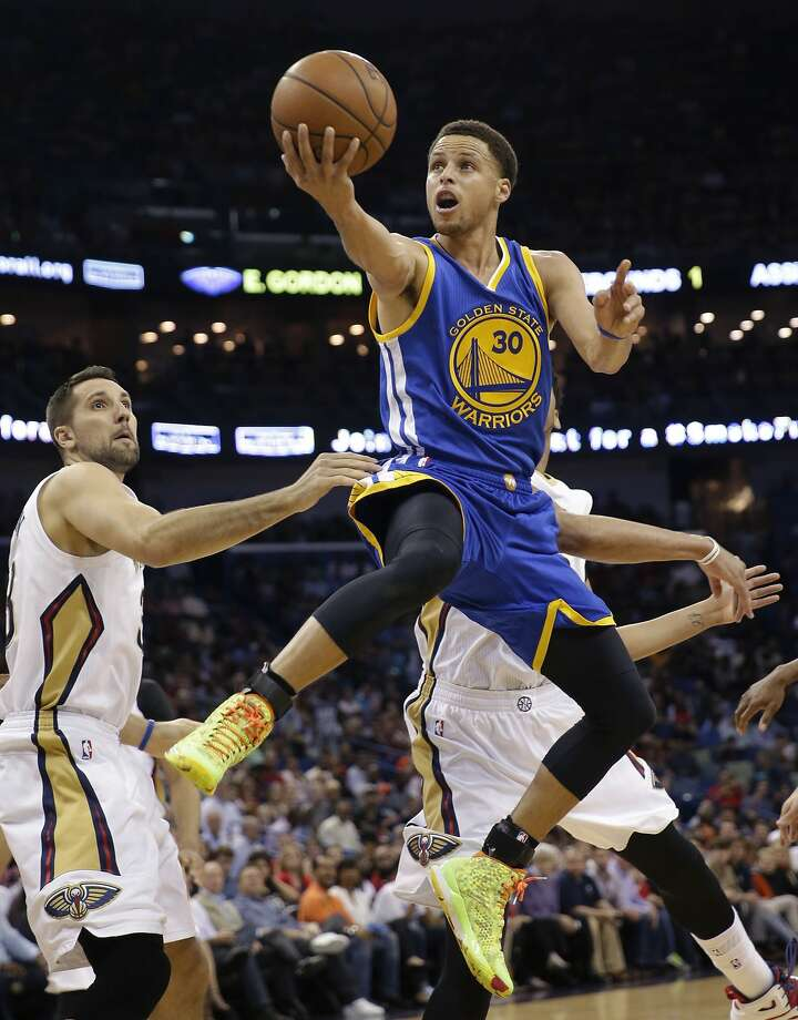 Golden State Warriors guard Stephen Curry (30) drives to the basket in front of New Orleans Pelicans forward Ryan Anderson in the first half of an NBA basketball game in New Orleans, Tuesday, April 7, 2015. (AP Photo/Gerald Herbert) Photo: Gerald Herbert, Associated Press
