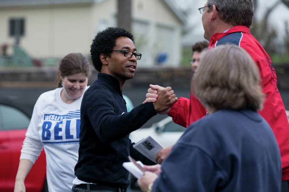 Wesley Bell, a City Council candidate, greets voters Tuesday outside a polling station in Ferguson. Bell defeated another black candidate, and his victory guaranteed the black representation on the council will double. Photo: WHITNEY CURTIS, STR / NYTNS