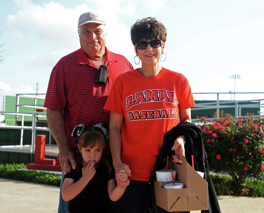 Butch, Debbie, and Abigelle Champagne, 4, pose for a photo Tuesday afternoon. The Lamar Cardinals hosted the Grambling Tigers on Tuesday afternoon. Photo taken Tuesday 4/7/15 Jake Daniels/The Enterprise Photo: Jake Daniels / ©2015 The Beaumont Enterprise/Jake Daniels