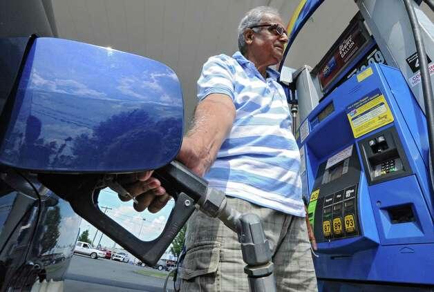 Krishna Sarathy of Niskayuna fills up his car with gas at $3.85 a gallon on Monday, July 15, 2013, in Niskayuna, N.Y.  (Lori Van Buren / Times Union archive) Photo: Lori Van Buren / 00023170A