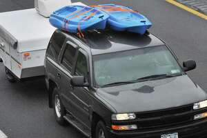 An SUV rigged for camping heads north on the Northway at the start of the Memorial Day weekend Friday, May 24, 2013, in Halfmoon, N.Y. (John Carl D'Annibale / Times Union archive)