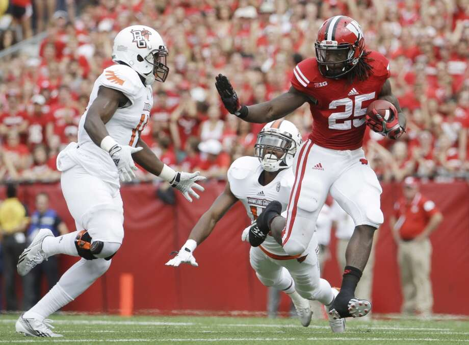 FILE - In this Sept. 20, 2014, file photo, Wisconsin's Melvin Gordon runs against Bowling Green during the first half of an NCAA college football game in Madison, Wisc. He's already put together a remarkable year. A Big Ten single-season record 2,336 yards rushing _ the fourth-highest mark in NCAA history. Twenty-nine touchdowns. He is just Wisconsin's fourth finalist for the Heisman Trophy, joining fellow running backs and winners Alan Ameche (1954) and Ron Dayne (1999); and Montee Ball, who finished fourth in 2011 and finished with an NCAA-record 83 touchdowns. (AP Photo/Morry Gash, File) Photo: Morry Gash, Associated Press