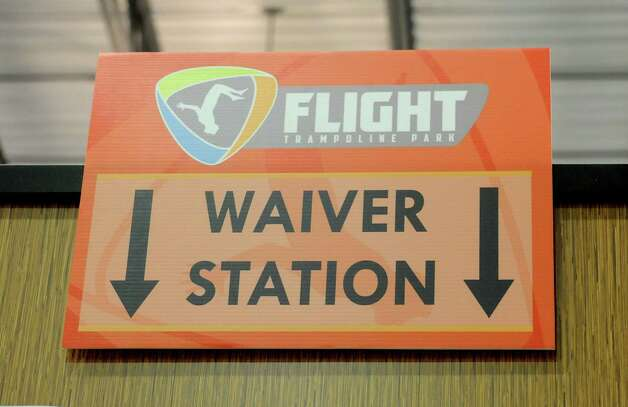 A sign at the waiver station in the Flight Trampoline Park at 30 A Post Rd. on Thursday, May 29, 2014 in Colonie, N.Y.  (Lori Van Buren / Times Union archive) Photo: Lori Van Buren / 00027053A