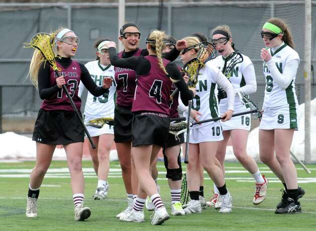 Burnt Hills Carly Grant,(4), is congratulated by teammate Nakona Wolfe, (7), after she scored a goal during their girls' high school lacrosse game against Shenendehowa on Tuesday, April 7, 2015, in Clifton Park, N.Y. (Michael P. Farrell/Times Union) Photo: Michael P. Farrell / 00031329A