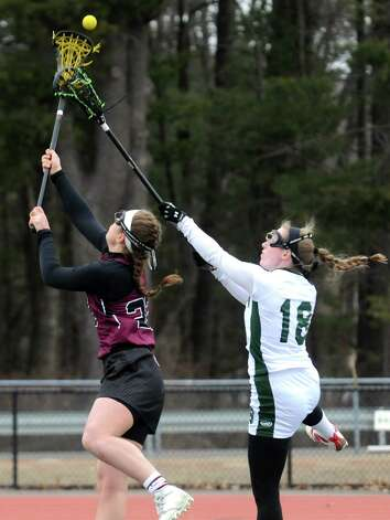 Burnt Hills Haley Schultz, left, and Shen's Meg Pendergast battle for the draw during their girls' high school lacrosse game on Tuesday, April 7, 2015 in Clifton Park, N.Y. (Michael P. Farrell/Times Union) Photo: Michael P. Farrell / 00031329A