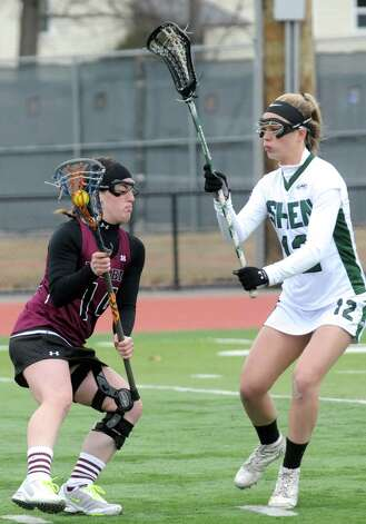 Burnt Hills Taylor Safford, left, tries to work her way around Shen's Courtney Guiry during their girls' high school lacrosse game on Tuesday, April 7, 2015 in Clifton Park, N.Y. (Michael P. Farrell/Times Union) Photo: Michael P. Farrell / 00031329A