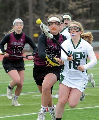 Burnt Hills Haley Schultz, left, and Shen's Emily Dinallo battle for the ball during their girls' high school lacrosse game on Tuesday, April 7, 2015, in Clifton Park, N.Y. (Michael P. Farrell/Times Union) Photo: Michael P. Farrell / 00031329A