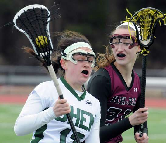 Shenendehowa's Melissa Rosenthal works her way around Burnt Hills Abby Bittner during their girls' high school lacrosse game on Tuesday April 7, 2015 in Clifton Park, N.Y. (Michael P. Farrell/Times Union) Photo: Michael P. Farrell / 00031329A