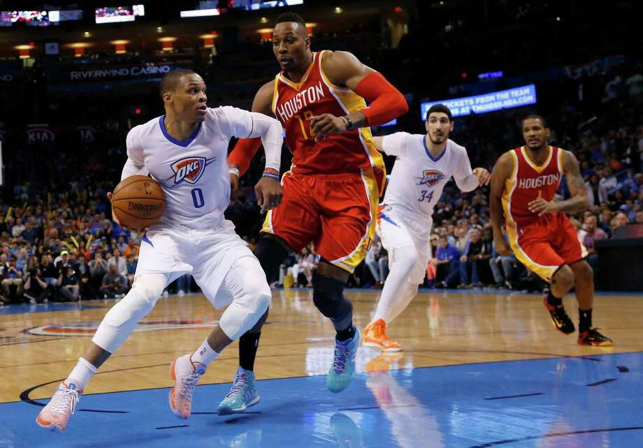 Dwight Howard, right, defending the Thunder's Russell Westbrook, could see more minutes, but the center's focus is preparation for the playoffs. Photo: Sue Ogrocki, STF / AP