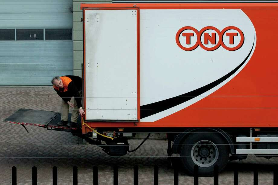 TNT Express is based in Hoofddorp, near Amsterdam, Netherlands. It has 65,000 employees. FedEx's deal to buy the company would give the U.S. company a sizable delivery network in Europe. Photo: Peter Dejong, STF / AP