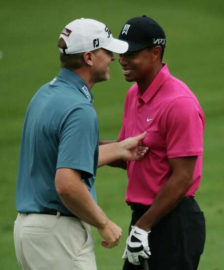 As part of the looseness that was evident as Tiger Woods made his way around Augusta National on Tuesday, Steve Stricker engages in some hijinks with his longtime friend. Photo: Chris Carlson, STF / AP