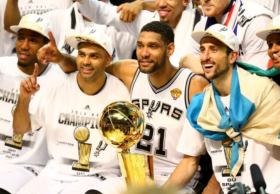 SAN ANTONIO, TX - JUNE 15:  Tony Parker #9 and Tim Duncan #21, and Manu Ginobili #20 of the San Antonio Spurs celebrate after defeating the Miami Heat in Game Five of the 2014 NBA Finals at the AT&T Center on June 15, 2014 in San Antonio, Texas. NOTE TO USER: User expressly acknowledges and agrees that, by downloading and or using this photograph, User is consenting to the terms and conditions of the Getty Images License Agreement.  (Photo by Andy Lyons/Getty Images) Photo: Getty Images