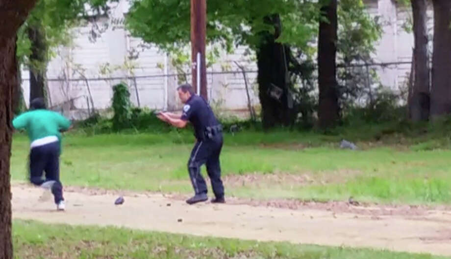 Video footage taken at the scene shows Officer Michael Thomas Slager shooting at Walter Lamer Scott as he runs away. Photo: Associated Press / L. Chris Stewart
