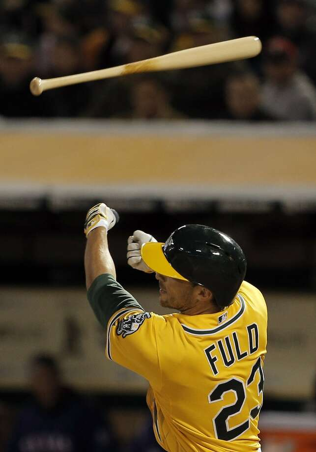Sam Fuld (23) loses the grip on his bat in the third inning as the Oakland Athletics played the Texas Rangers at O.Co Coliseum on Tuesday, April 7, 2015, in Oakland, Calif. Photo: Carlos Avila Gonzalez, The Chronicle