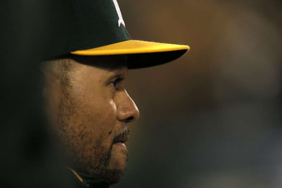 Coco Crisp (4) watches from the dugout as the Oakland Athletics played the Texas Rangers at O.Co Coliseum on Tuesday, April 7, 2015, in Oakland, Calif. Photo: Carlos Avila Gonzalez, The Chronicle