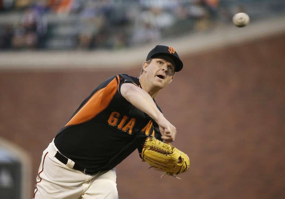 San Francisco Giants starting pitcher Matt Cain throws against the Oakland Athletics during the first inning of an exhibition baseball game Friday, April 3, 2015, in San Francisco. (AP Photo/Eric Risberg) Photo: Eric Risberg, Associated Press