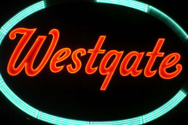 The Westgate Plaza sign is lit up at night in this Times Union file photograph. Dismantled for renovations last year, the landmark sign is being put back in place on Wednesday. (Skip Dickstein/Times Union)