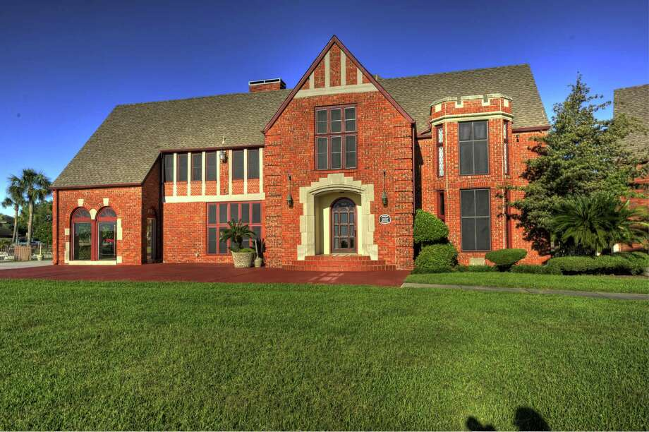 Windmere, a 1929 English Tudor red brick home, will be featured on Houston Symphony League Bay Area's Day by the Bay Home Tour April 11-12. Photo: Courtesy