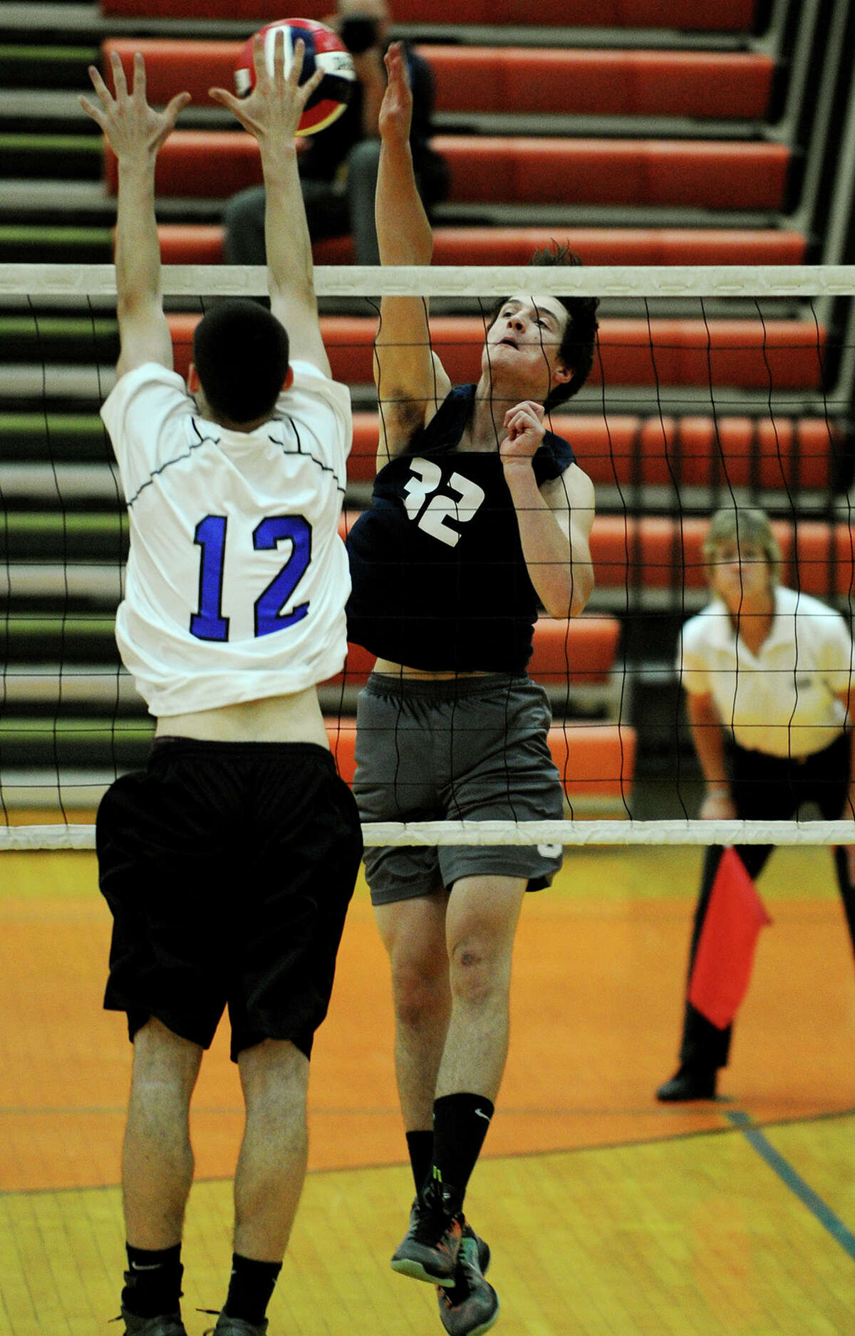 Staples' Chris Delaurentis spikes the ball as a Southington defender attempts to block during the Wreckers' loss in the Class L state boys volleyball semifinals at Shelton High School in Shelton, Conn. on Monday, June 9, 2014.