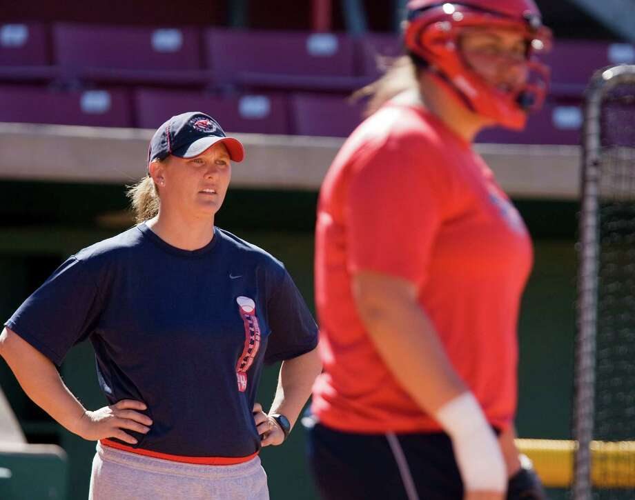 The University of Houston girls softball head coach Kyla Holas (left) and catcher Elaina Nordstrom (right) during a team practice Wednesday, Feb. 11, 2009, in Houston.