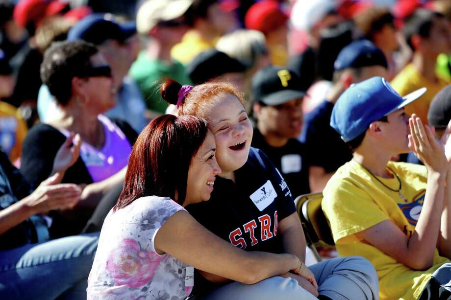 Irmar Castillo, left, of Cypress, with daughter Vanessa Castillo, 16, a Miracle League baseball player, at the grand opening of the J.E. & L.E. Mabee Adaptive Sports Complex at the Langham Creek Family YMCA Saturday, March 28, 2015, in Houston, Texas. The $2.4 million facility consist of an artificial turf baseball field, a covered multipurpose pavilion, a barrier-free playground, to be built later, and a lush green space at its center. The baseball field will be home to the Miracle League, a youth baseball program dedicated  to children with physical and mental disabilities. ( Gary Coronado / Houston Chronicle ) Photo: Gary Coronado, Staff / © 2015 Houston Chronicle