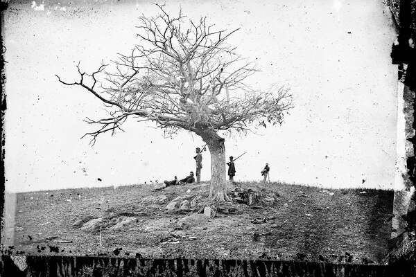 "This 1862 photo made available by the Library of Congress shows soldiers next to a lone grave after the Battle of Antietam near Sharpsburg, Md. When dawn broke along Antietam Creek on Sept. 17, 1862, cannon volleys launched a Civil War battle that would leave 23,000 casualties on the single bloodiest day in U.S. history and mark a crucial pivot point in the war. And yet it might never have occurred - if not for what a historian calls a ""freakish"" twist of fate. Days earlier, a copy of Gen. Robert E. Lee's detailed invasion orders, wrapped around a few cigars, accidentally fell in a farm field and were discovered by Union infantrymen who passed their stunning find up the chain of command, spurring action."