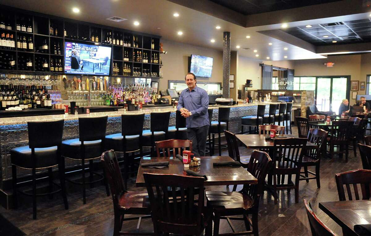 The Republic Grille owner Terry McBurney in the main dining area of his restaurant. The Republic Grille is located in the Panther Creek Village Center in The Woodlands. Photograph by David Hopper