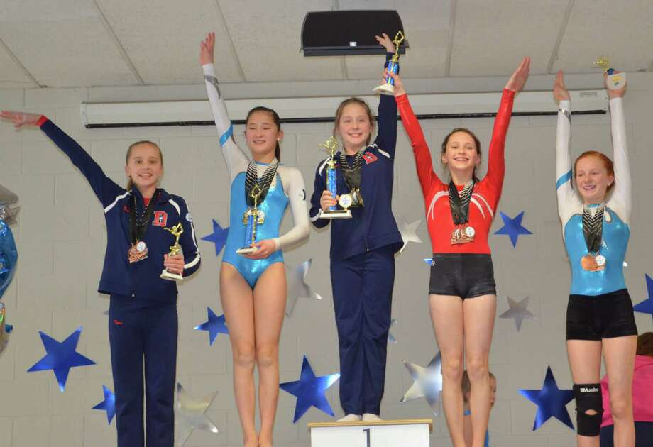 Darien YMCA Level 6 gymnast Lana Schmidt was the All Around champion at the 2015 Connecticut State Championships while teammate Tess Keating placed fourth. Photo: Contirbuted, Contributed / Darien News