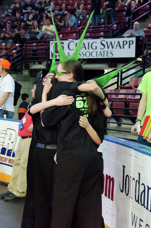 Pit Crew member Libby Perego (center) celebrates with other members of the teamé­s Pit Crew after winning the Utah Regional Robotics Tournament. Photo: Courtesy CRyptonite