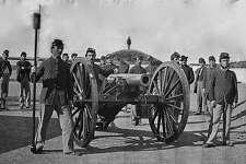 Artillery Team, One soldier holds the sponge by a large mobile cannon.
