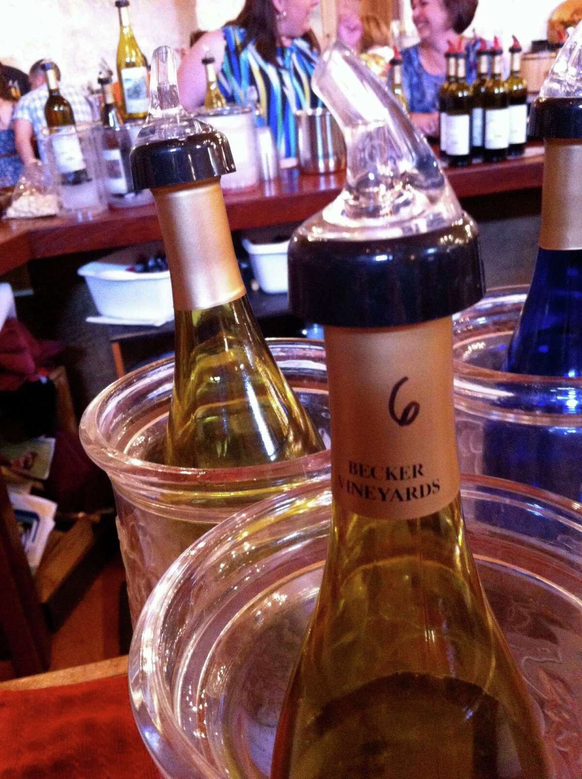 Chilled bottles of wine are ready to be sampled in the popular Becker Vineyards tasting room.