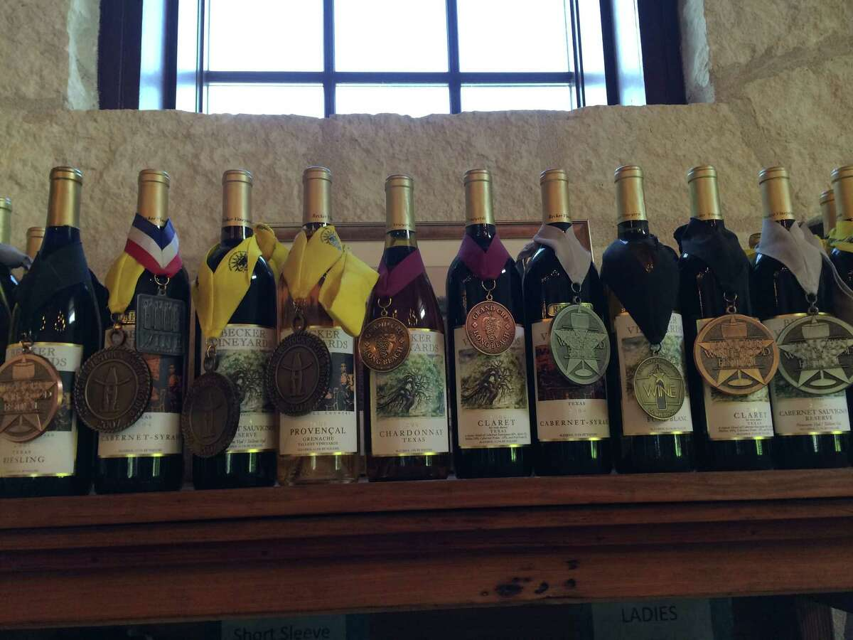Some of the many awards won by Becker Vineyards wines are showcased high on a shelf at the winery between Johnson City and Fredericksburg.