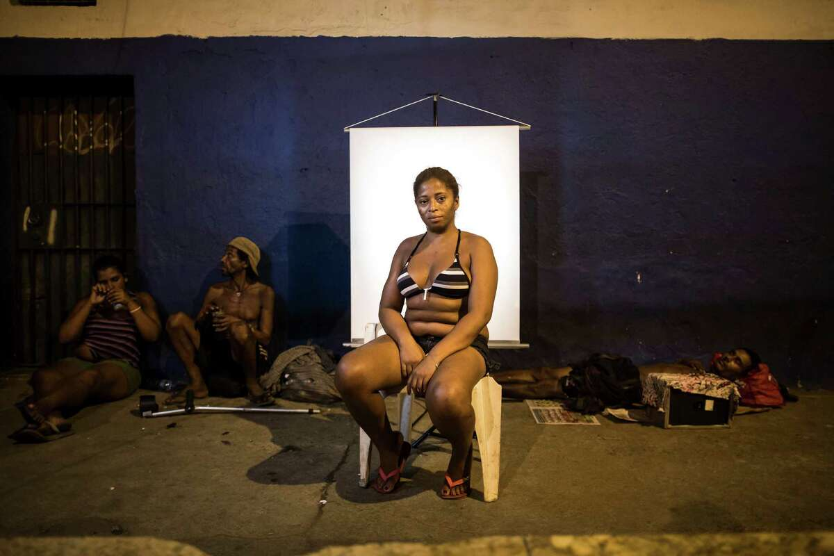 In this March 14, 2015 photo, Valeria de Brito, 36, poses for a portrait in an open-air crack cocaine market, known as a