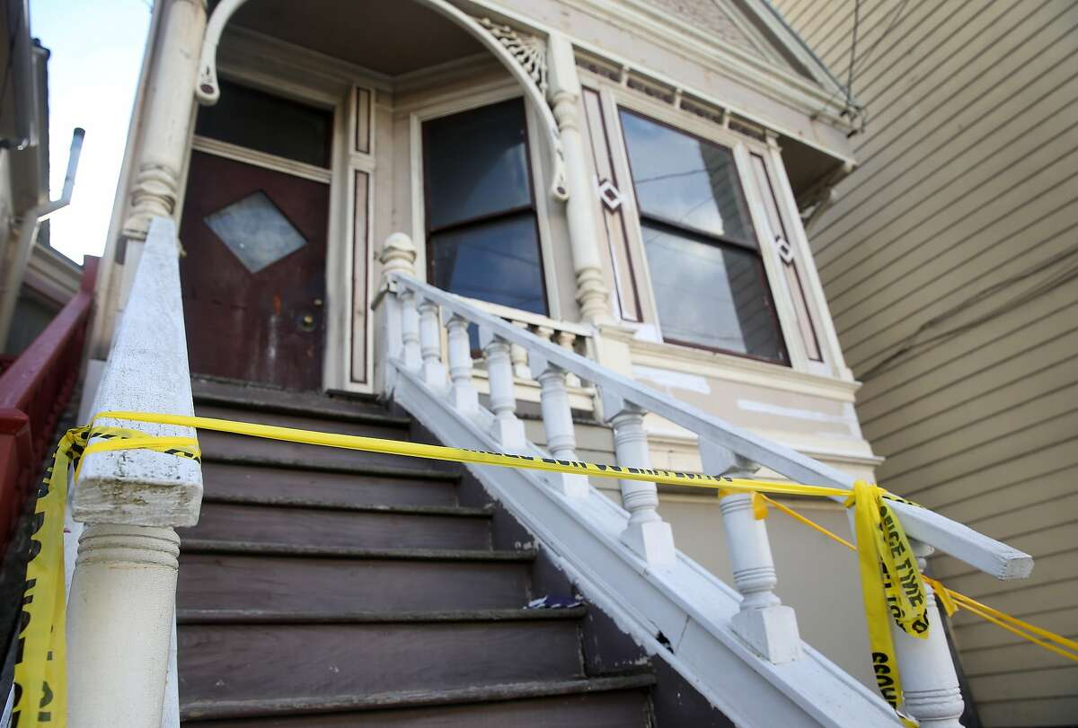 Crime scene tape remains on a stairway leading to a home on Fourth Avenue in San Francisco, Calif. on Wednesday, April 8, 2015, where a mummified body was removed over the weekend.