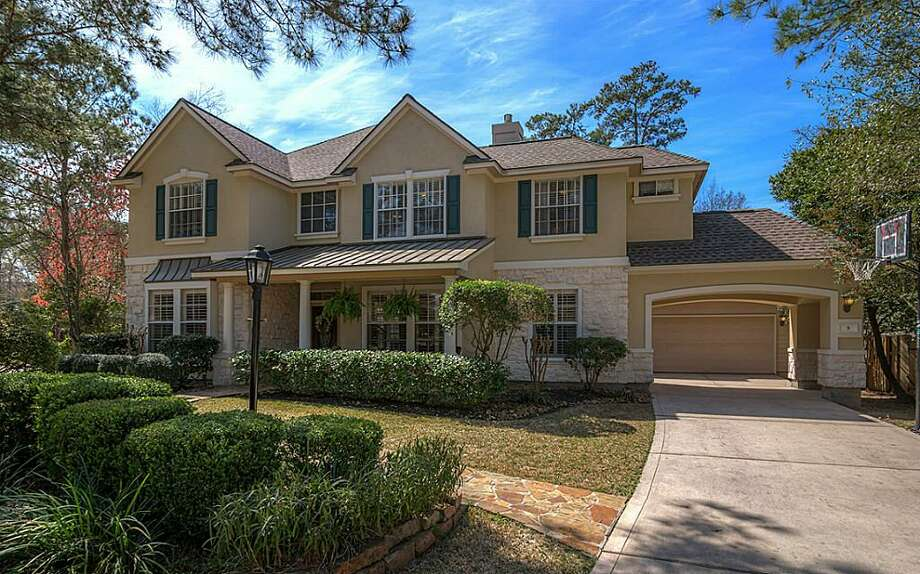 3 Petaldrop Place: $545,000 / 5 bedrooms / 5 full and 1 half bathrooms Photo: Houston Association Of Realtors